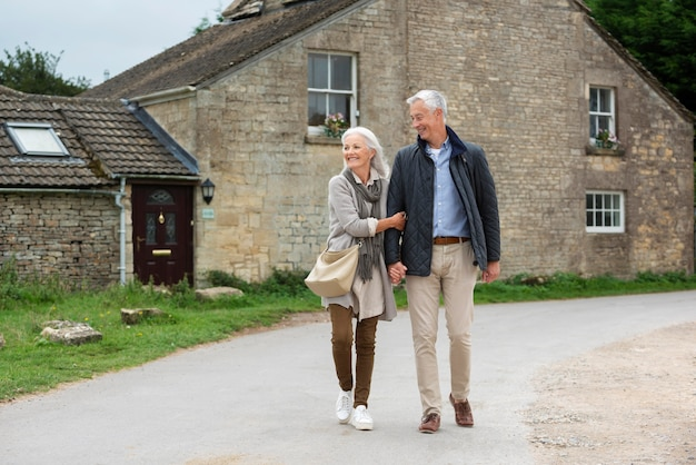 Adorable senior couple being affectionate while taking a walk