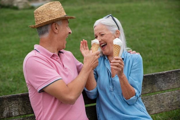 Adorable senior couple enjoying some ice cream together outdoors