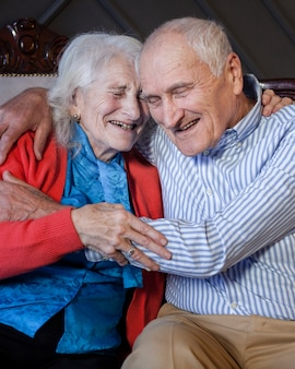 Adorable senior man and woman laughing
