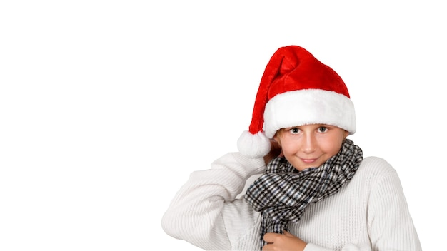Adorable smiling boy with christmas red hat