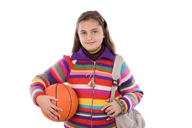 Adorable student girl with basketball on a over white background