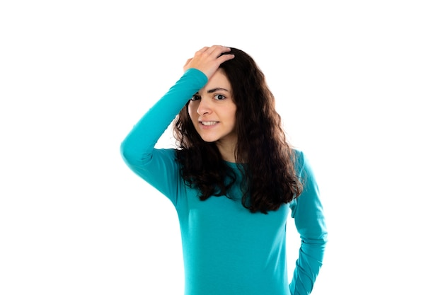 Adorable teenage girl with blue sweater isolated on a white wall