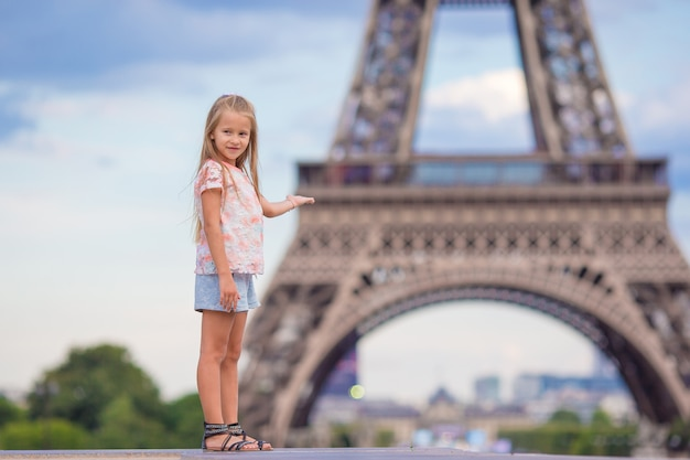 Adorable toddler girl in paris the eiffel tower during summer vacation