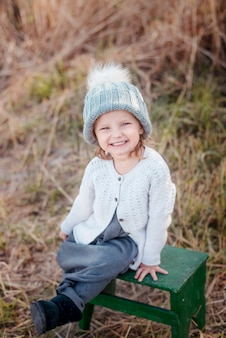 Adorable toddler girl portrait on beautiful autumn day