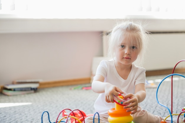 Adorable toddler in playroom