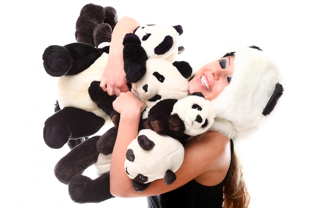 Adorable woman with lots of stuffed pandas