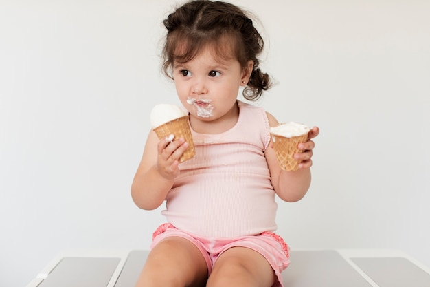 Adorable young baby girl with ice cream