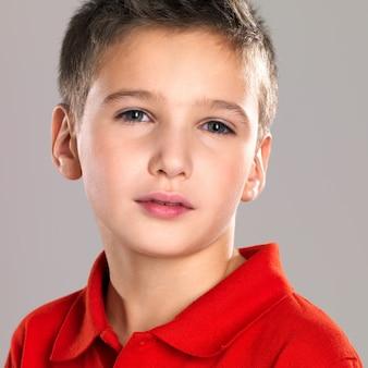 Adorable young beautiful boy posing