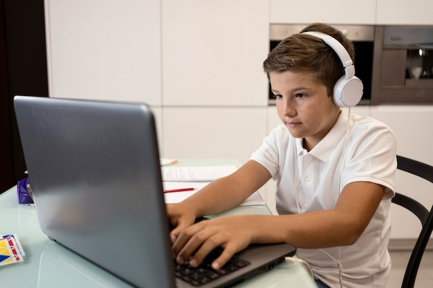 Adorable young boy doing his homework