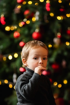 Adorable young boy playing with christmas toys