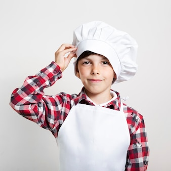 Adorable young boy ready to cook