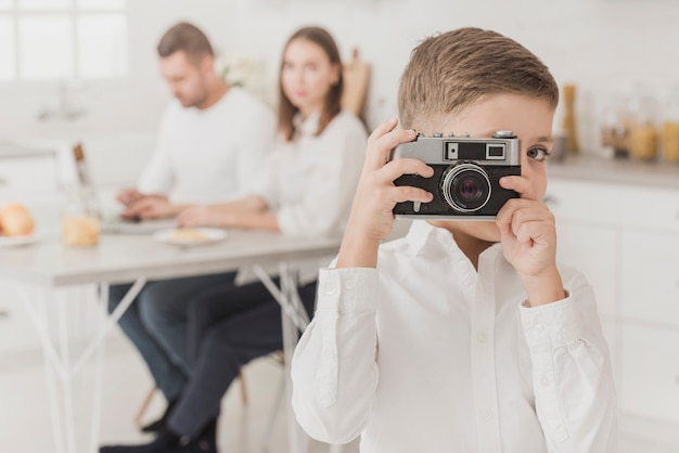 Adorable young boy taking a picture
