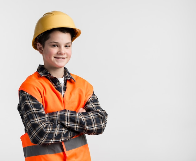 Adorable young boy with hard hat on