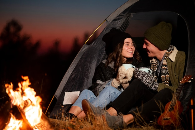 Adorable young couple next to a bonfire
