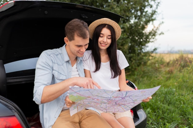 Adorable young couple checking local map