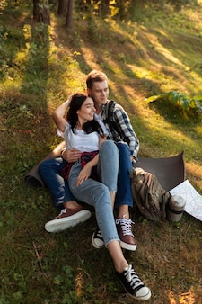 Adorable young couple relaxing outdoors