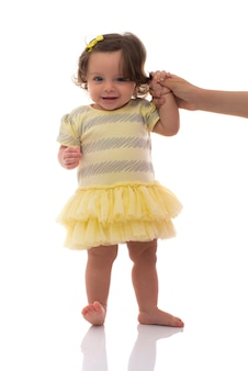 Adorable young girl first steps