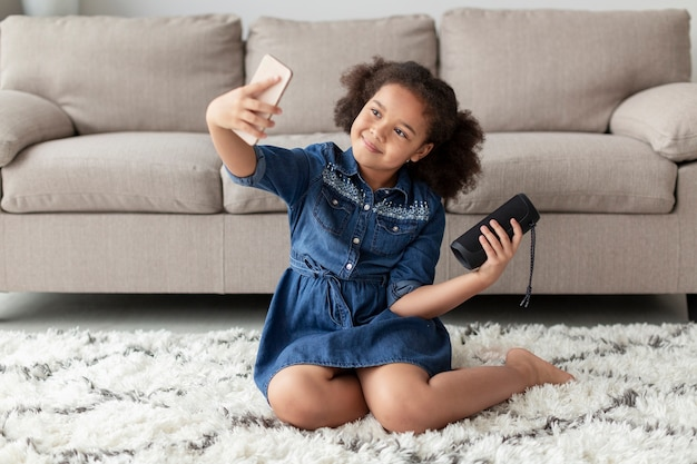 Adorable young girl taking a selfie