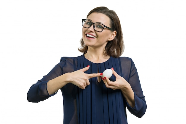 Adult attractive woman pointing at white egg