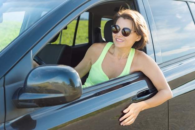 Adult attractive woman sitting in car
