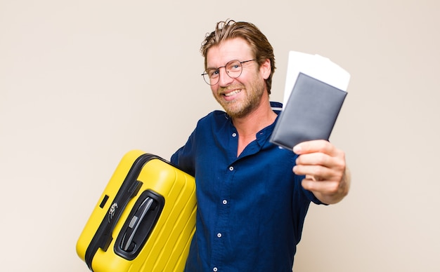 Adult blonde man with a case travel concept.