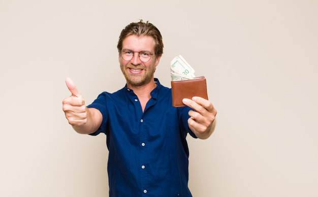 Adult blonde man with a wallet and dollar banknotes