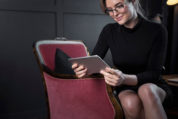 Adult businesswoman checking a tablet