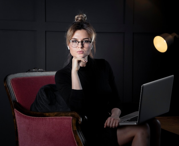 Adult businesswoman with eyeglasses posing
