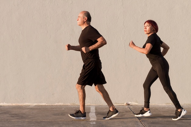 Adult couple doing sport and running