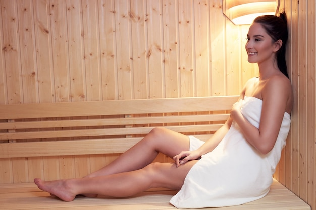 Adult couple relaxing in sauna