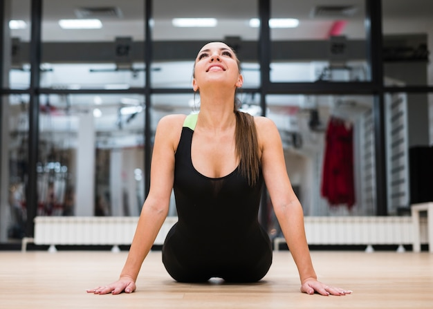 Adult fit woman training at the gym