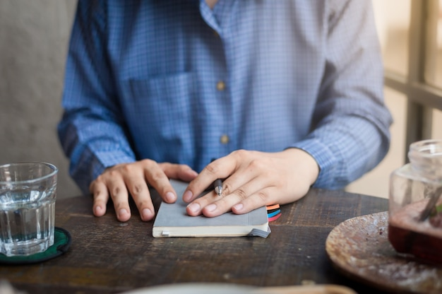 Adult freelance businessman writing on notebook