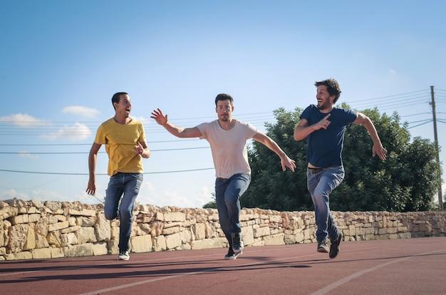 Adult guys having fun and running