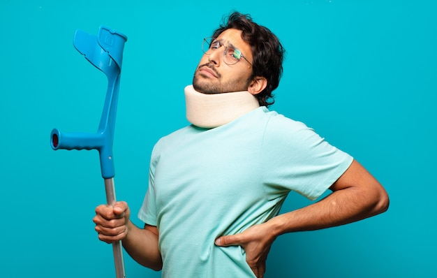 Adult handsome indian man who has suffered an accident.