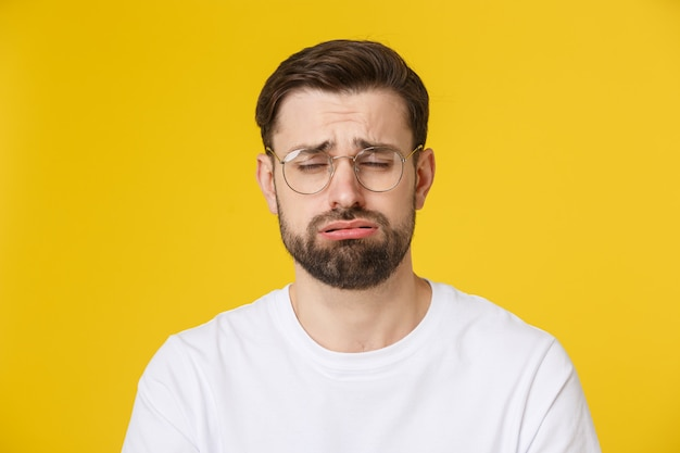 Adult hispanic man over isolated depressed and worry for distress, angry and afraid. sad expression