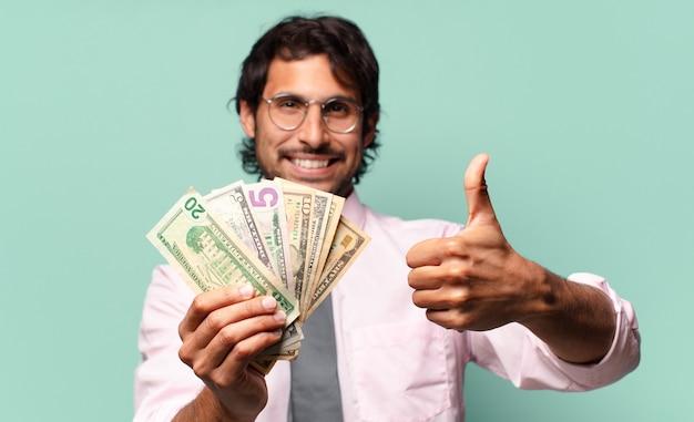달러 지폐와 성인 인도 사업가