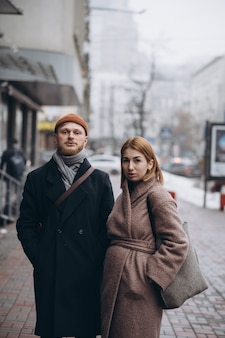 Adult loving couple walking on a street