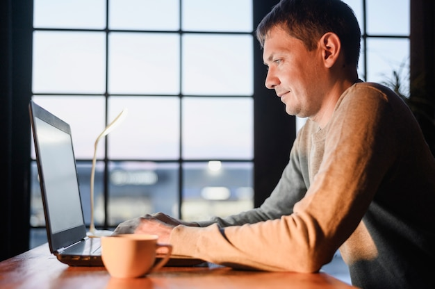 Adult male doing remote work from home