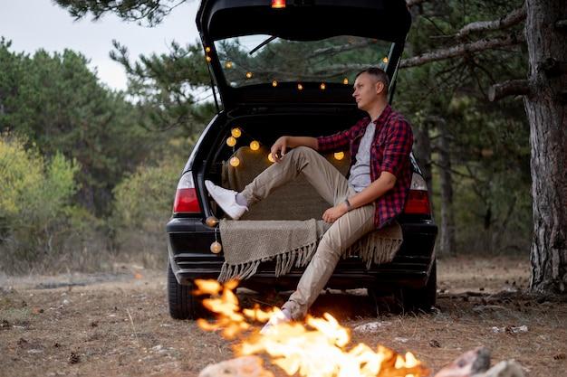 Adult male enjoying bonfire