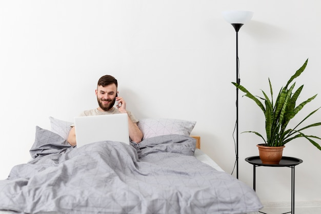 Adult male enjoying work from home