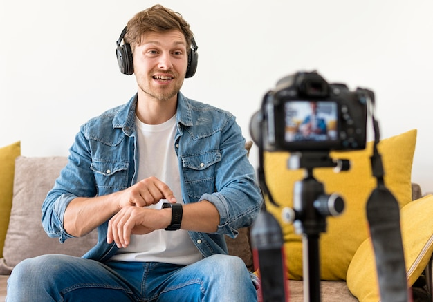 Adult male recording with headphones on