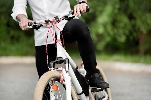 Adult male riding modern bicycle outdoors