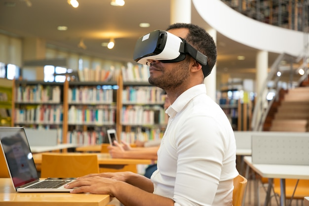 Adult male student with vr headset