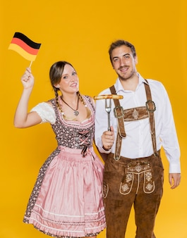 Adult male and woman celebrating oktoberfest