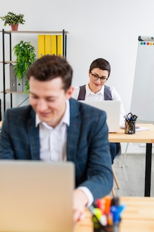 Adult male and woman working at the office