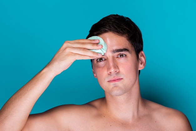 Adult man applying soap moisturizer