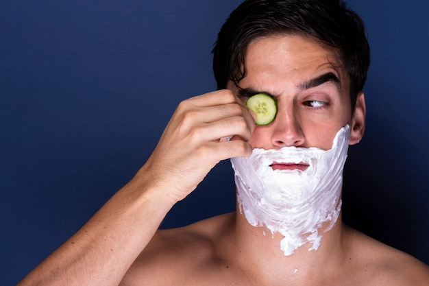 Adult man applying wellness treatment