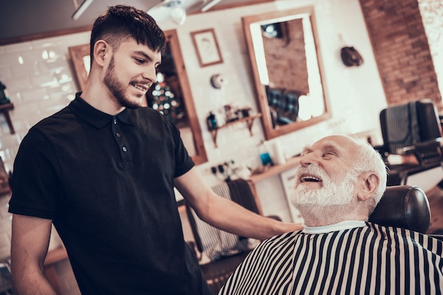 Adult man came to young barber for style haircut