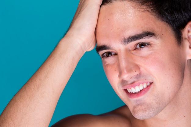 Adult man grooming hair close-up