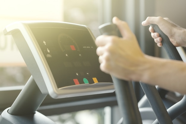 Adult man making cardio training exercises in gym club